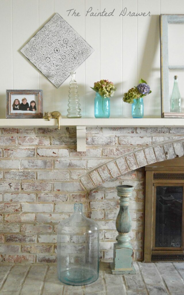 Old Window Brick Mantel www.thepainteddrawer.com