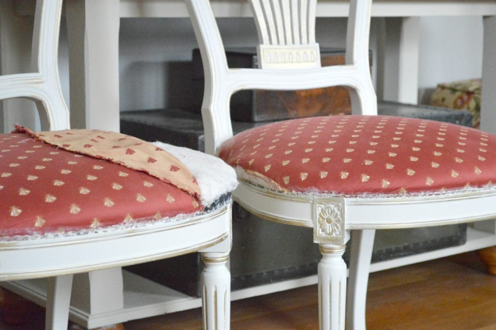 Vintage Balloon Back Dining Room chairs with Gold Gilding wax over antique white paint at www.thepainteddrawer