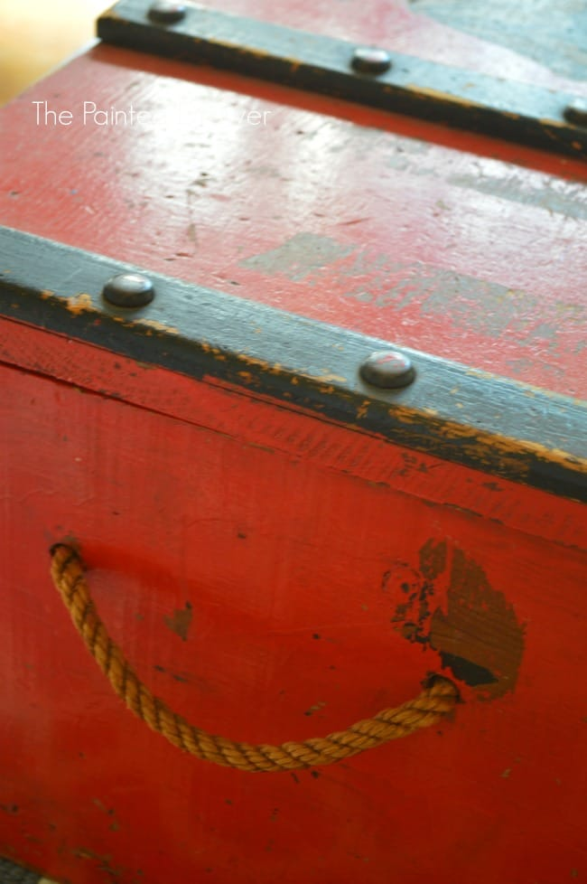 Vintage Chest with Rope Handle and Pirate Motif